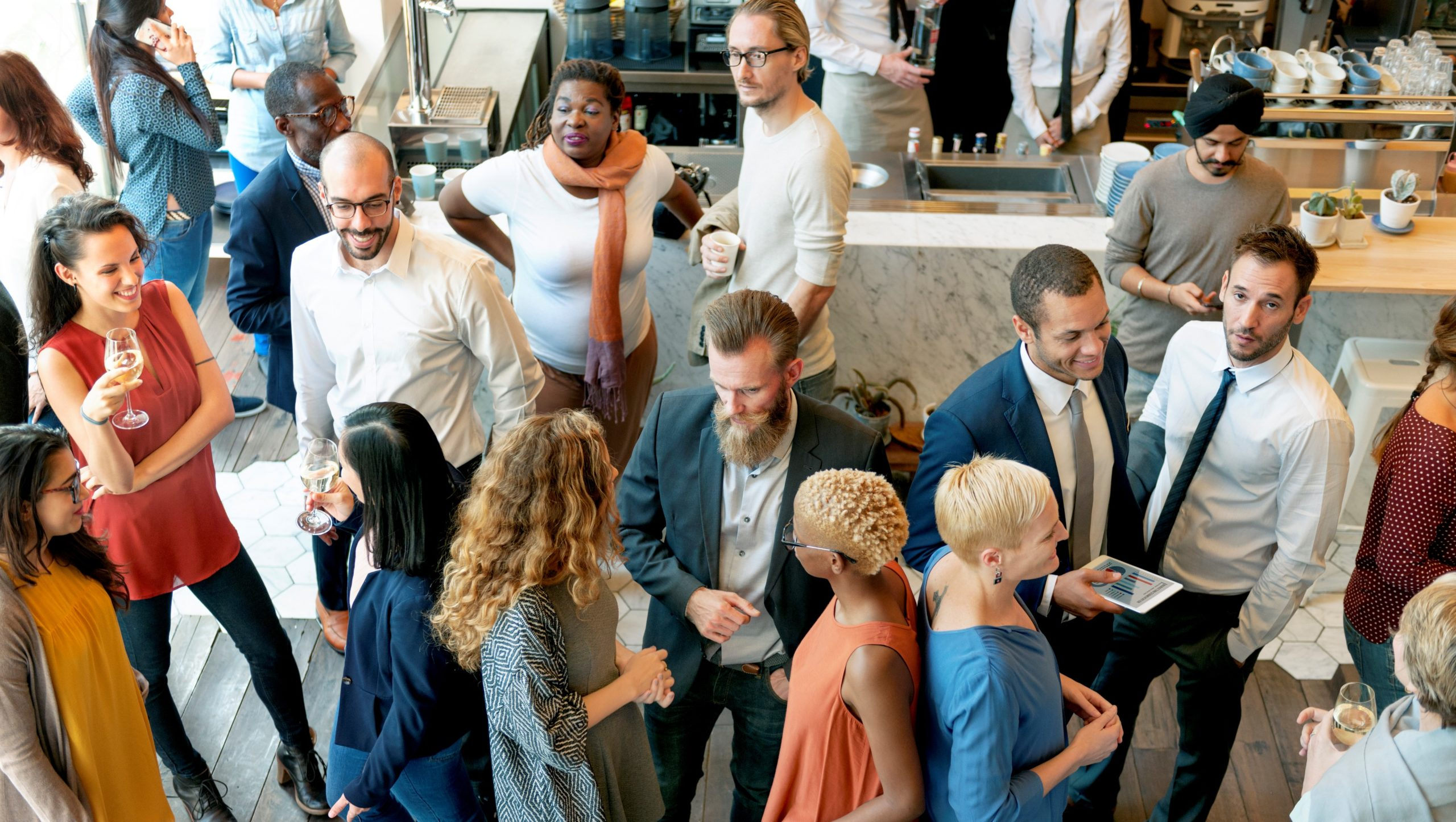Diverse group of people talking and eating at a casual networking event
